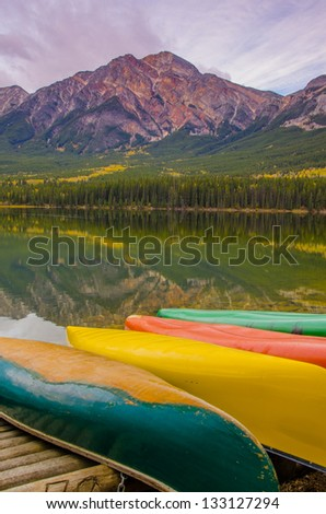 Canoes by a stunning lakeside - stock photo