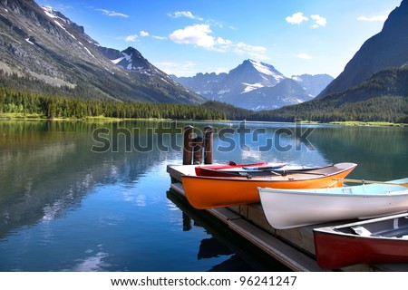 Canoes by lake Mc Donald in Glacier national park - stock photo