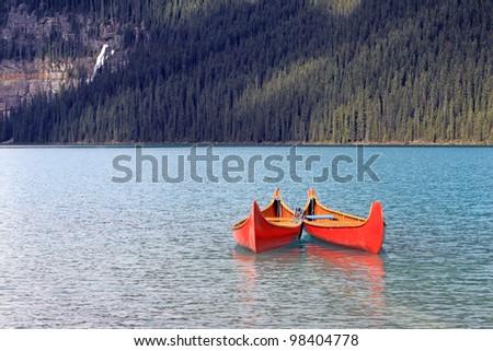 Canoes on Lake Louise. Canada - stock photo