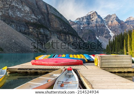 Canoes on Moraine Lake in the Banff National Park canada - stock photo