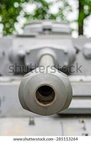canon of an old russian tank aiming straight on me - stock photo