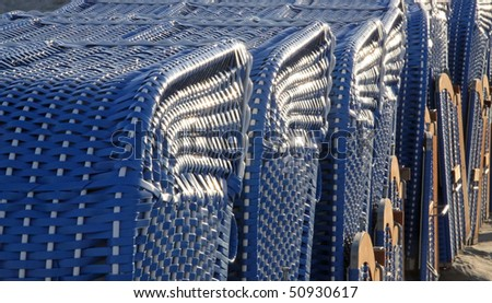 Canopied beach chairs - close-up view - stock photo