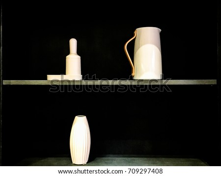 Cans and vases in the shelf, nice interior wooden design