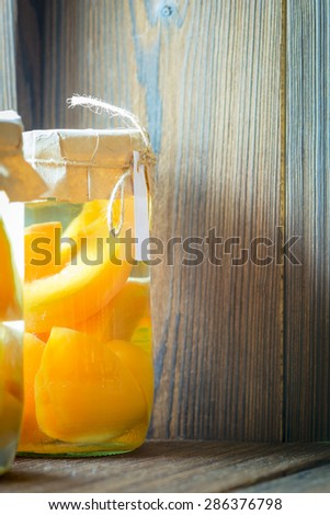 cans with peach compote made at home - stock photo