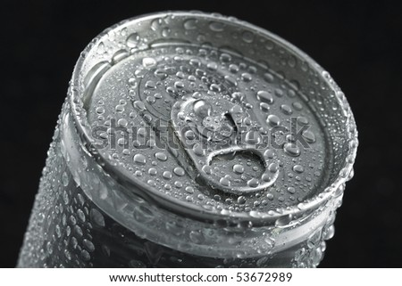 cans with water droplets on black background  - stock photo