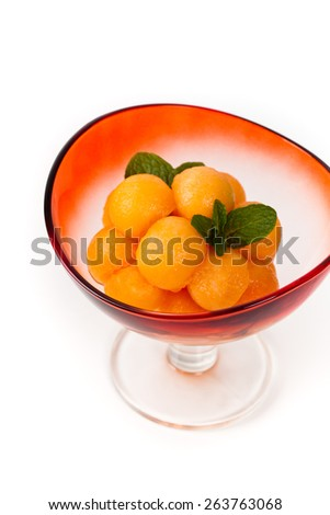 Cantaloupe Melon and Mint on white background. Shallow dof. Selective soft focus. - stock photo