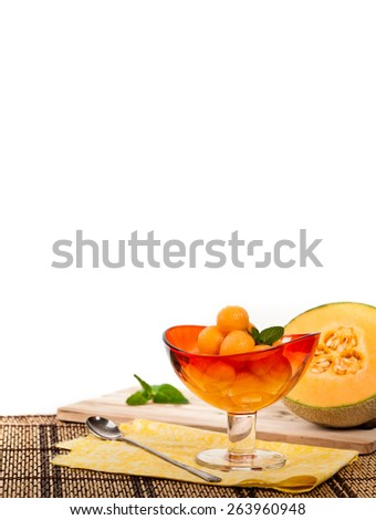 Cantaloupe Melon and Mint on white background. Shallow dof. Selective soft focus.