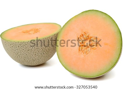 cantaloupe melon cut in half isolated on white  - stock photo