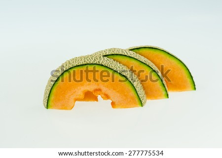 cantaloupe melon slices isolated on white background with clipping path. - stock photo