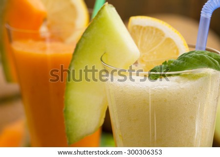 Cantaloupe smoothie or milkshake with fruit and lemon