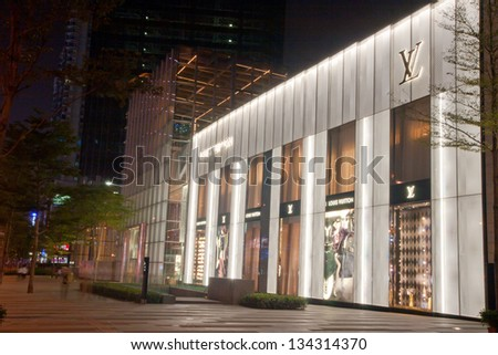 CANTON,CHINA  - OCT 16: Louis Vuitton shop on Oct 16, 2011 in Canton. Forbes claims Louis Vuitton was the most powerful luxury brand in the world in 2008 with $19.4bn USD value. LV was founded in 1854 - stock photo