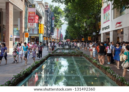 CANTON, CHINA - SEPTEMBER 06: The Beijing Road in Guangzhou on SEPTEMBER 06,2012. Famous shopping street with many shops and restaurants was reconstructed - stock photo