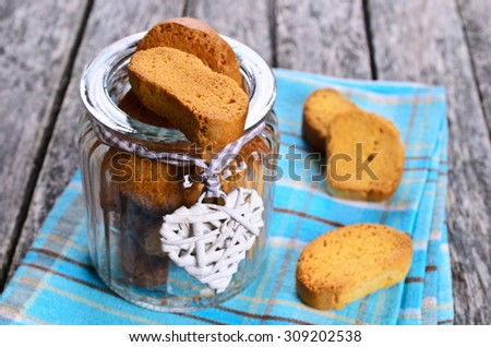 Cantucci little in a glass jar on a napkin in a rustic style