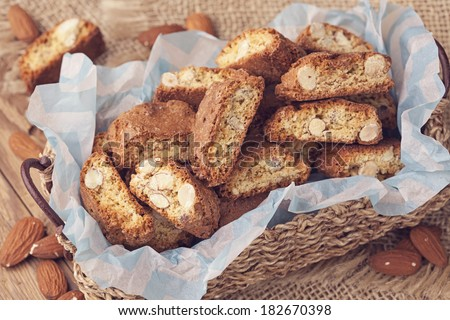 Cantuccini almond biscuits stacked on a brown background - stock photo