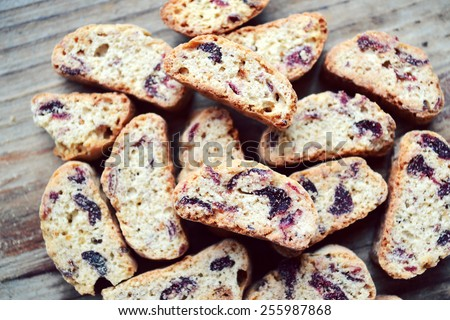 Cantuccini cookies with cranberry on wooden table - stock photo