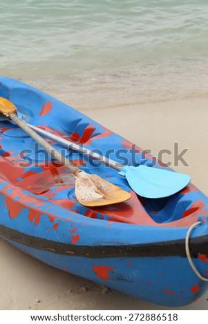 Canue, kayak close up ith paddle. - stock photo