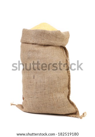 Canvas bag with cornmeal. Isolated on a white background. - stock photo