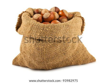 Canvas bag with hazelnuts isolated on white background