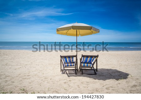 canvas bed with umbrella on the beach
