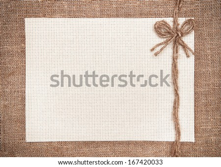 Canvas card with rope bow on hessian