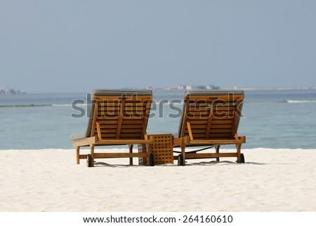 Canvas Chairs on tropical beach,Maldives - stock photo