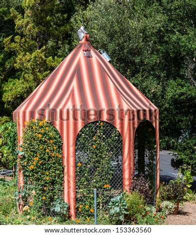 Canvas gazebo in park - stock photo