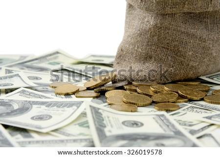 Canvas money sack  dollar bills, isolated on white background. - stock photo