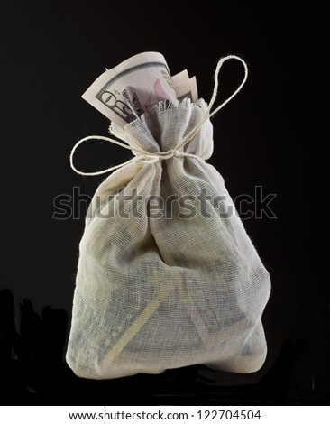 Canvas money sack with a lot fifty dollar bills - stock photo