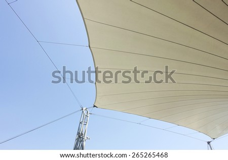 Canvas roof and blue sky background - stock photo