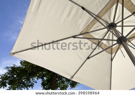 Canvas umbrella on a terrace during Summer holidays - stock photo