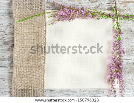 Canvas with heather and sacking ribbon - stock photo