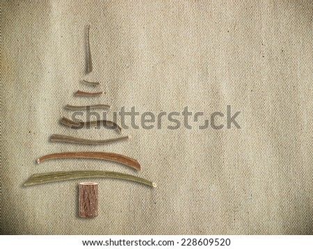 canvas with wooden christmas tree - stock photo