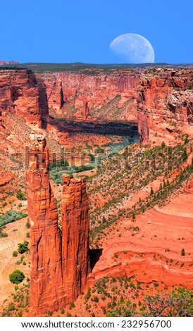 Canyon de Chelly and moon Navajo indian reservation northern Arizona - stock photo