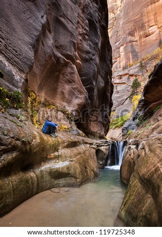 Canyon Solitude (Young Man Enjoys View of Beautiful Canyon) - stock photo