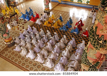 Cao Dai ceremony mass in Tay Ninh in Vietnam South East Asia - stock photo