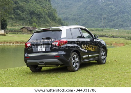 Caobang, Vietnam - Nov 24, 2015: A Suzuki New Vitara car crossing grass fields in test drive in Vietnam. - stock photo