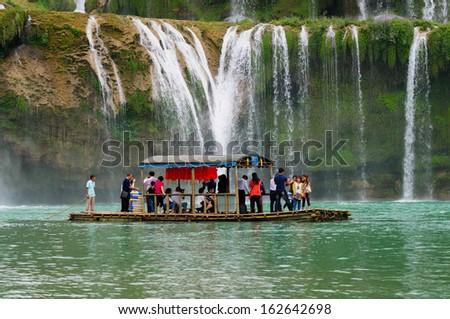 CAOBANG, VIETNAM, NOVEMBER 10: Tourist visit Ban Gioc waterfall by boat on November 10, 2013 in Caobang, Vietnam. Ban Gioc waterfall is along Vietnamese and Chinese board.