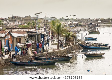 CAP-HAITIEN, HAITI - NOV 17, Unidentified people on their daily life by Mapou river after the devastation and poverty left in part by the 2010 earthquake on November 17, 2013 in Cap-Haitien, Haiti.