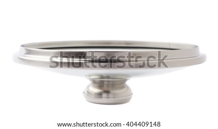 Cap of stainless steel metal cooking pot pan over isolated white background - stock photo