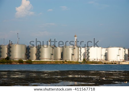 capacities for storage of oil products on the seashore - stock photo