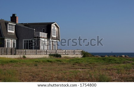 Cape Cod house. - stock photo