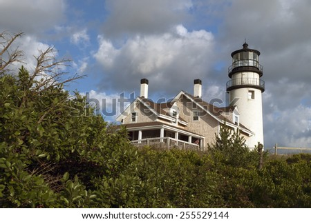 Cape Cod lighthouse is one of the first and oldest lighthouses on the Cape. It is located on the Cape Cod National Seashore. - stock photo