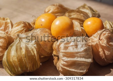 Cape gooseberry (Physalis) on wooden table, healthy fruit and vegetable - stock photo