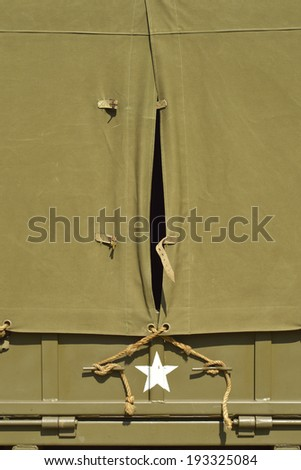 Cape in canvas top of vintage American military vehicle - space for text - stock photo