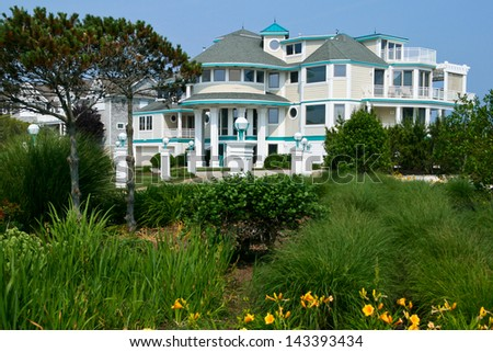 CAPE MAY, NJ - JUNE 9: Apartment house and garden on June 9, 2011 in Cape May. Cape May is said to be the oldest vacation resort in the United States.