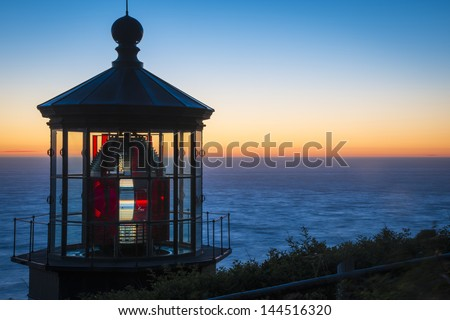 Cape Meares Lighthouse at sunset on the Oregon Coast - stock photo