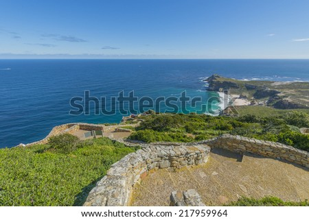 Cape Point is located near the city of Cape Town, South Africa. The peninsula has towering rock cliffs and lighthouse that overlook the beautiful ocean view. A tourism and travel hot spot. - stock photo