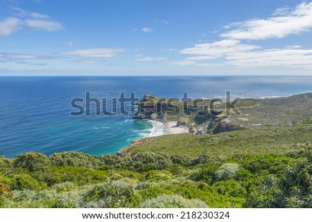 Cape Point landscape, located near the city of Cape Town, South Africa. The peninsula has towering rock cliffs that overlook the beautiful ocean view. A tourism and travel hot spot.