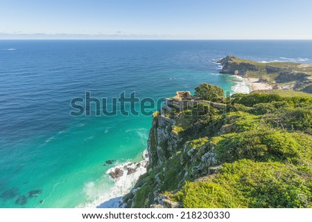 Cape Point landscape, located near the city of Cape Town, South Africa. The peninsula has towering rock cliffs that overlook the beautiful ocean view. A tourism and travel hot spot. - stock photo