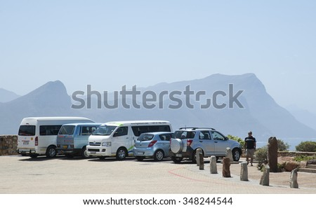 CAPE POINT SOUTH AFRICA - CIRCA 2013 - Tourists and touring transport at Cape Point South Africa